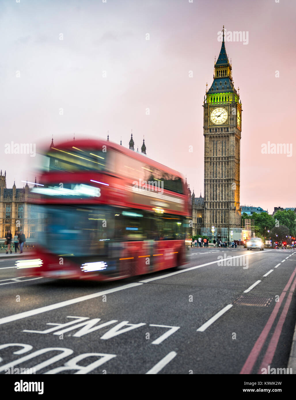 Red double-decker bus on the Westminster Bridge, evening twilight, Palace of Westminster and Big Ben, motion blur, - Stock Image