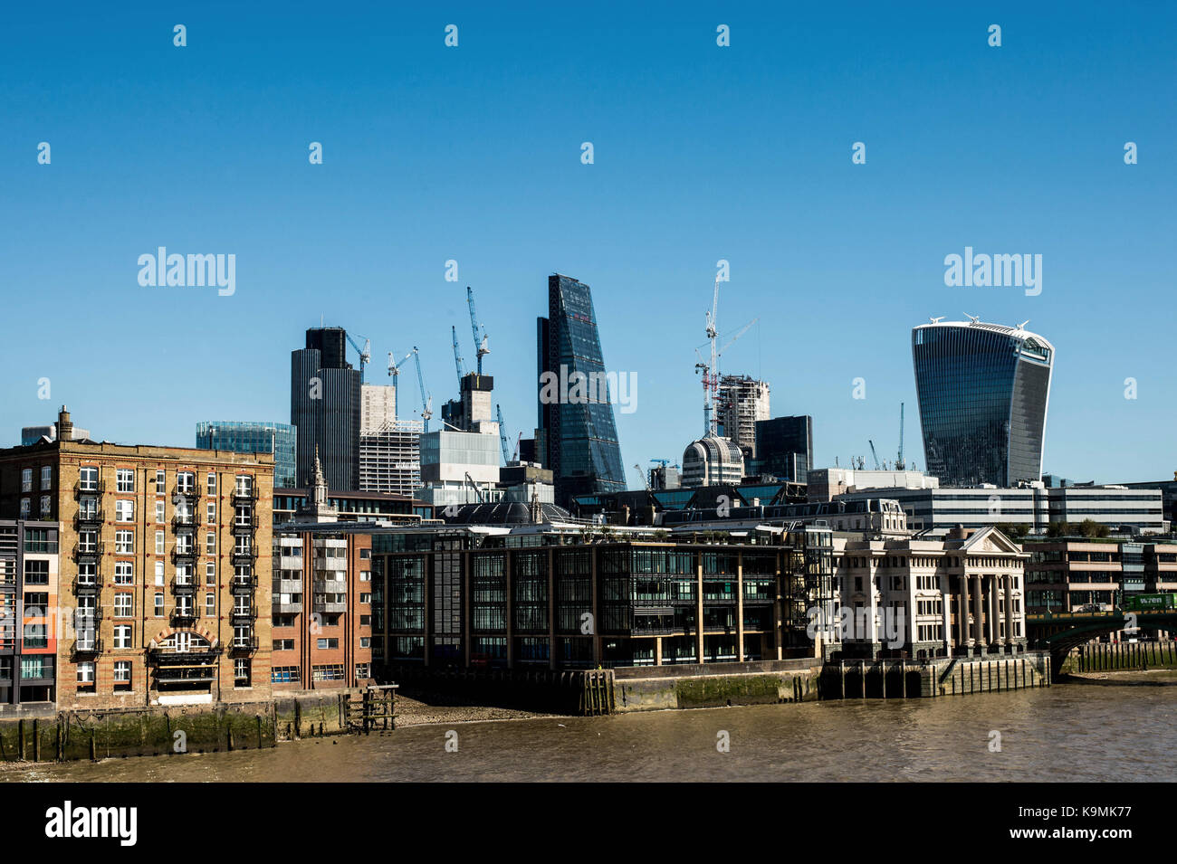 Two City of London Landmark Buildings the Walkie Talkie and Cheese Grater Skyscrapers Tower above Londons' Square - Stock Image