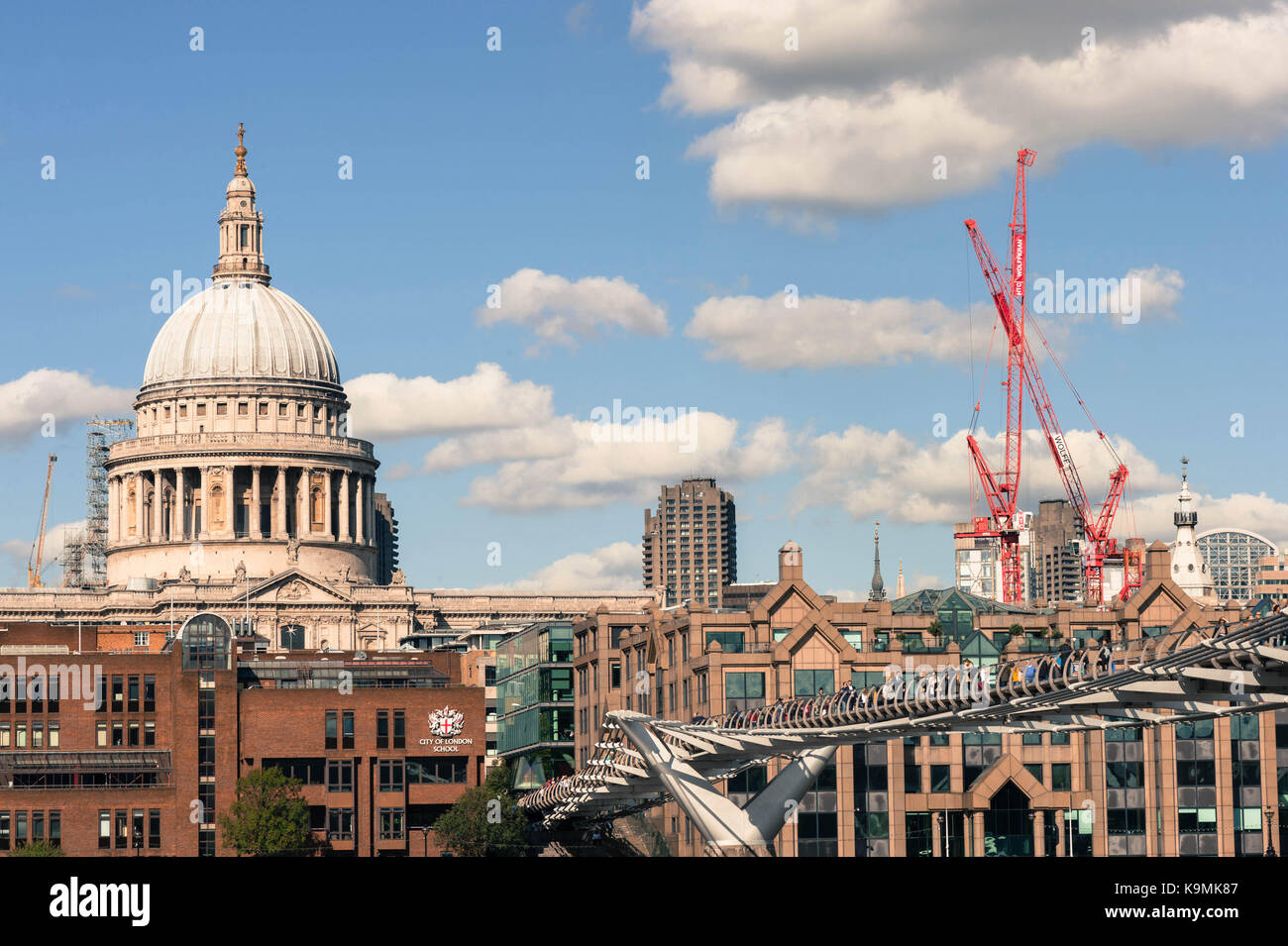 St Pauls Cathedral and the Millennium Footbridge Crossing the River Thames With the City of Londons Square Mile - Stock Image