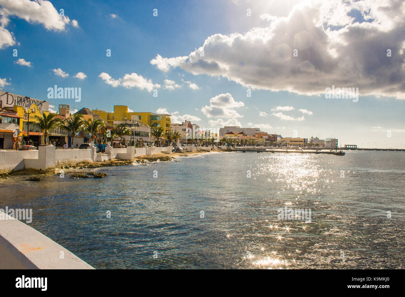 San Miguel boardwalk on the island of Cozumel, Mexico seen from a dock. - Stock Image