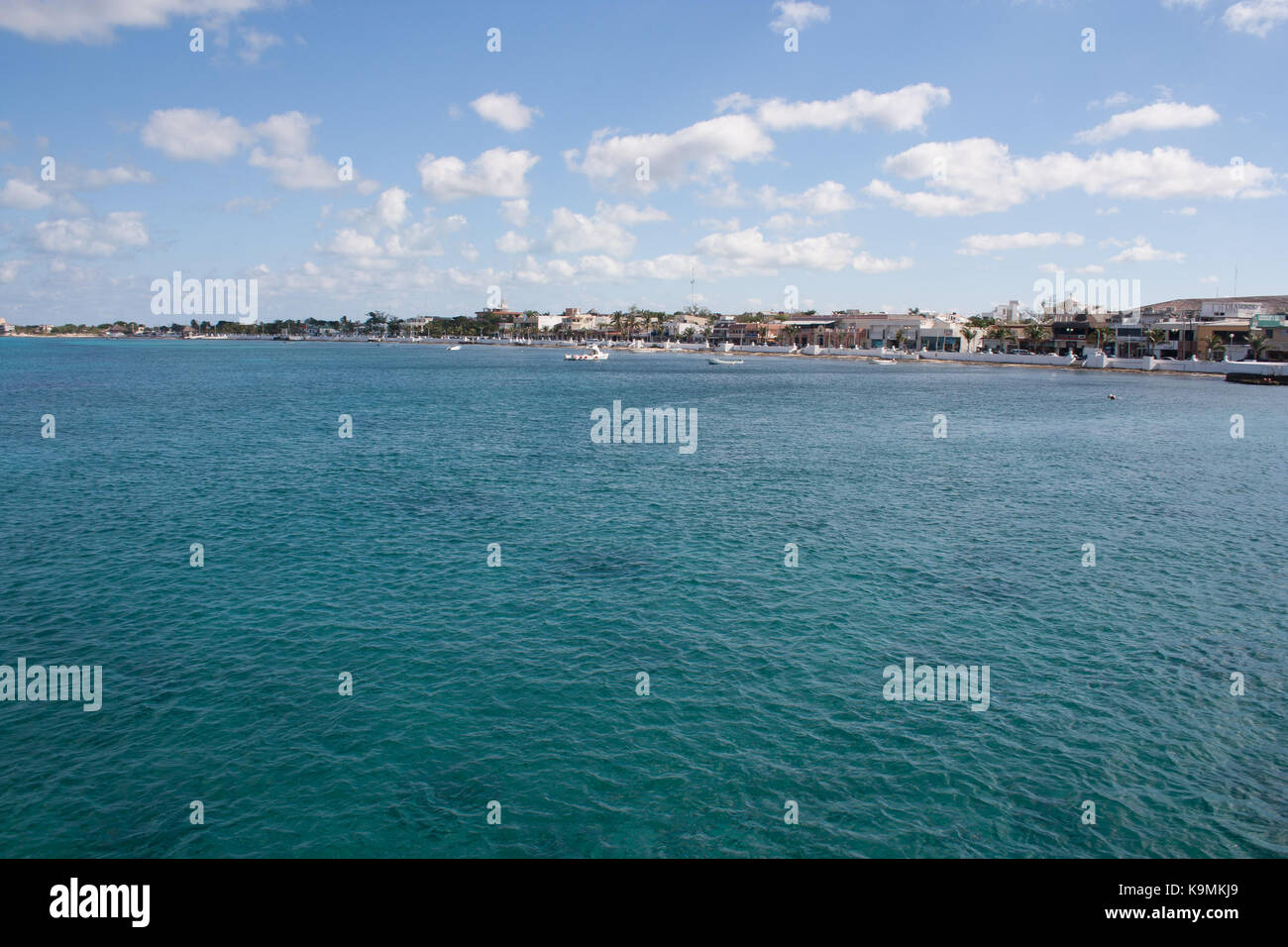 Views of the San Miguel coastline on the island of Cozumel, Mexico seen from a boat on the sea. - Stock Image