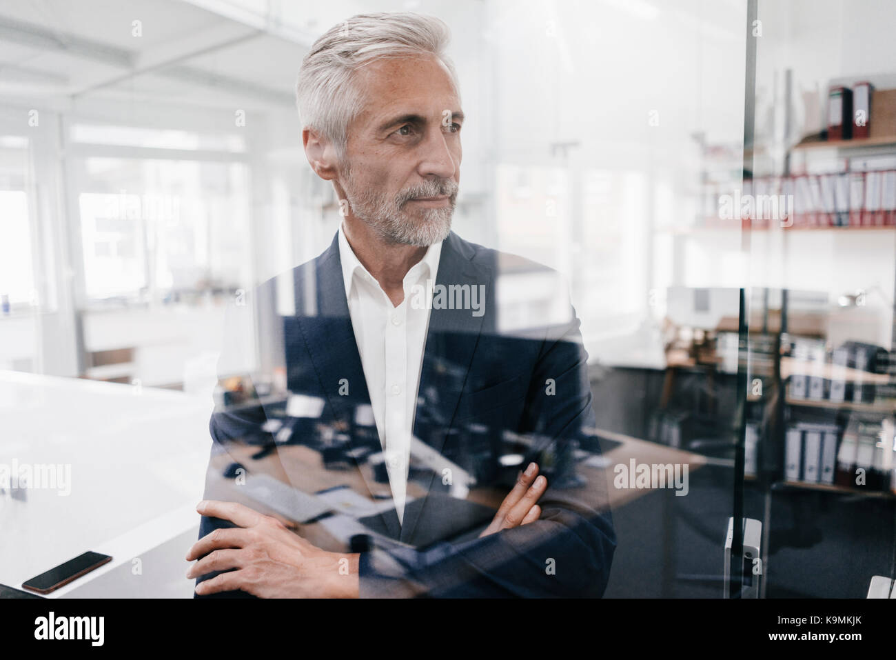 Confident mature businessman in office - Stock Image