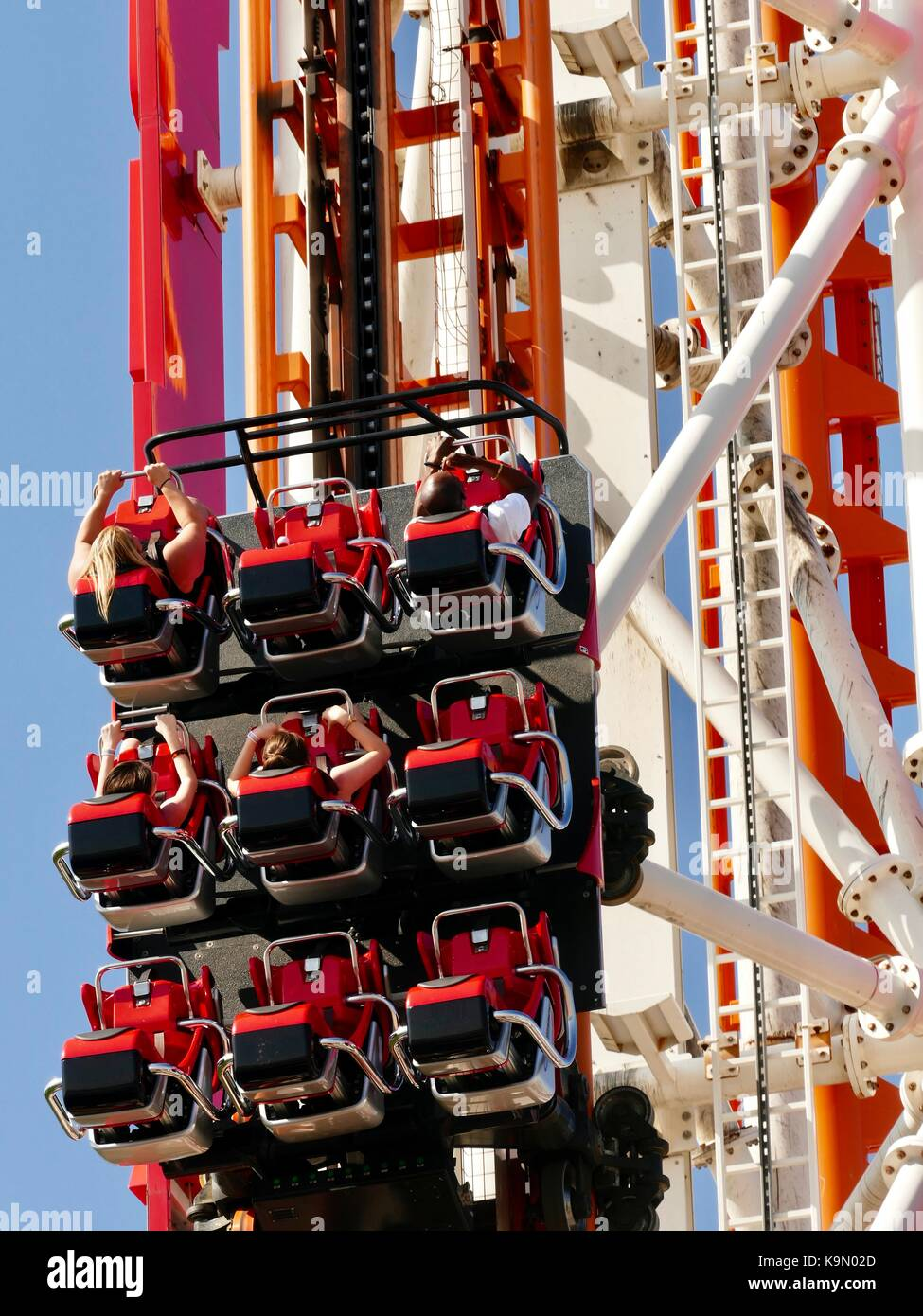 Close up of roller coaster riders climbing to loop over the top. Coney Island, New York, NY, USA. - Stock Image