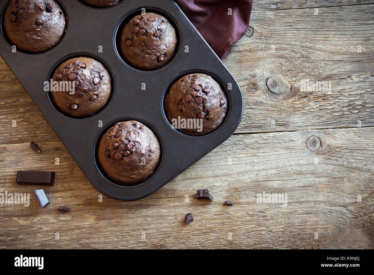 Chocolate Muffins with Chocolate Drops. Homemade chocolate pastry for breakfast or dessert. - Stock Image