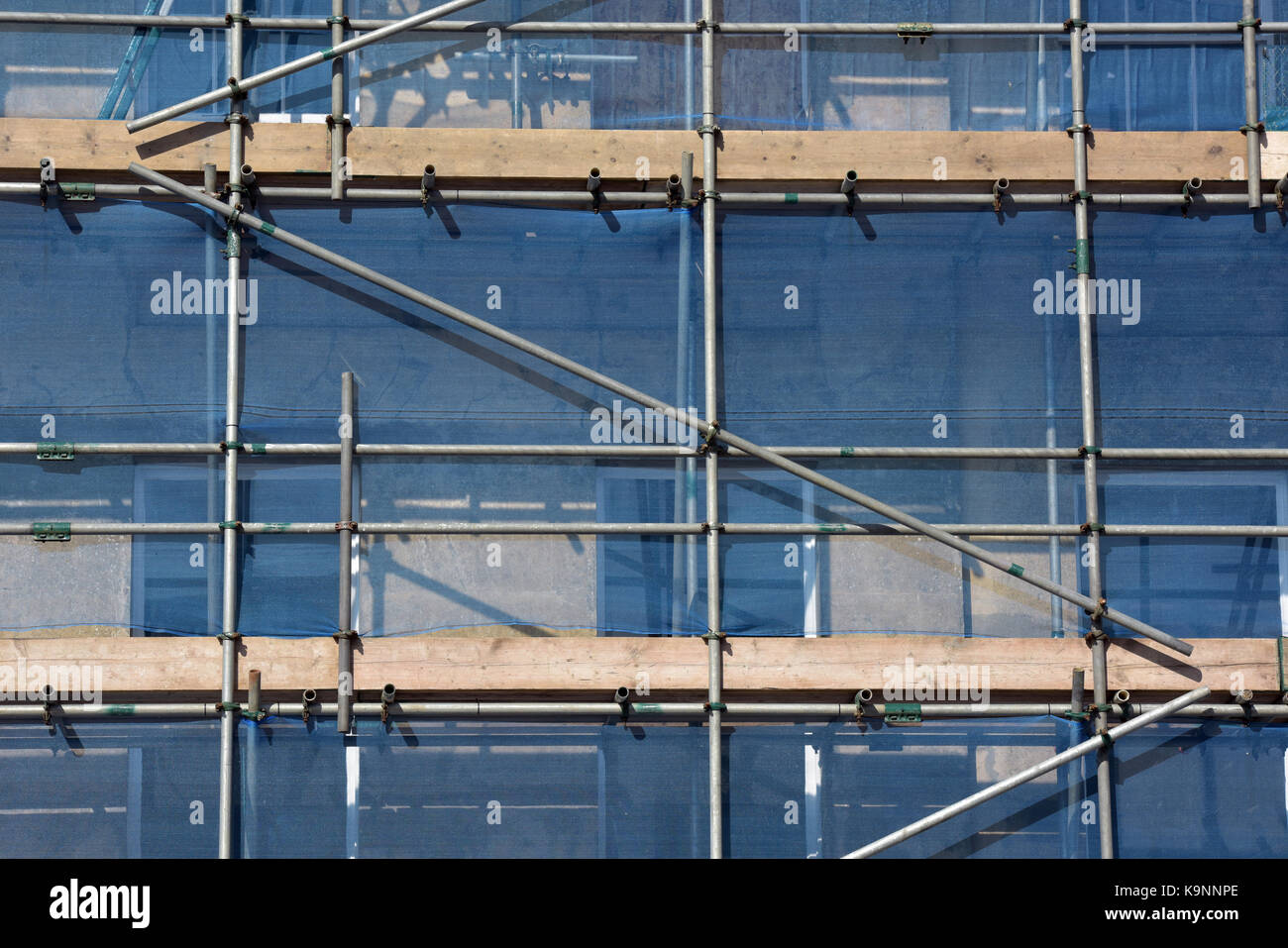 Some scaffolding erected on the front of a period building to allow access for works on restoration to be carried Stock Photo