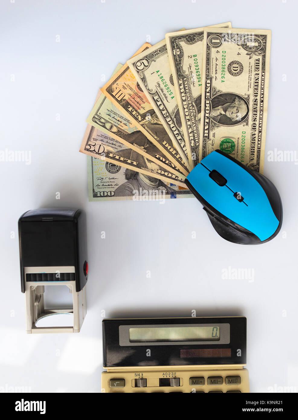 Business concept: computer mouse, seal, old calculator, money located opposite each other on a white background Stock Photo