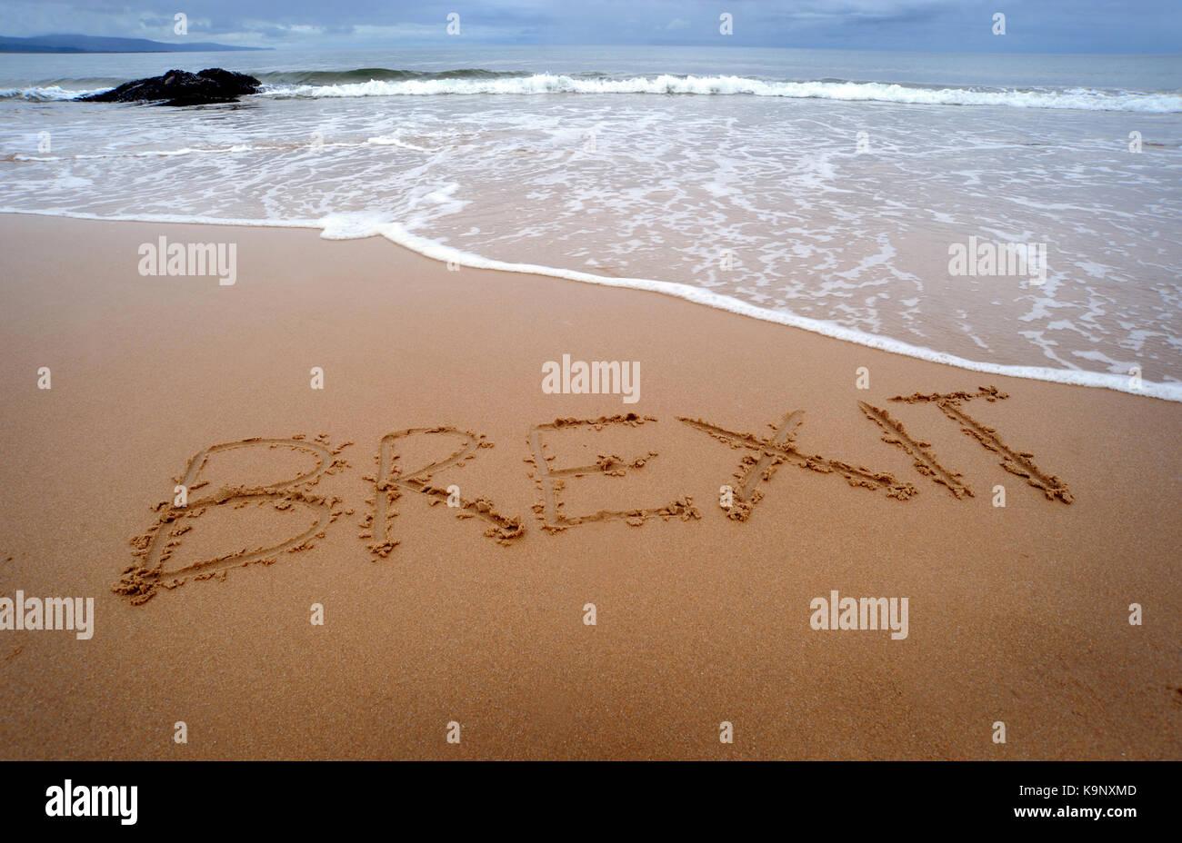 BREXIT WRITTEN IN SAND ON BRITISH BEACH UK - Stock Image