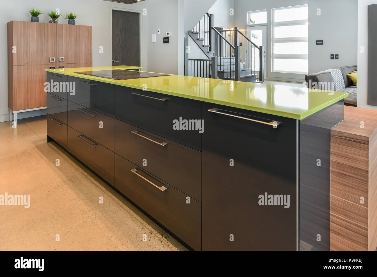Modern kitchen with green quartz island close up Stock Photo