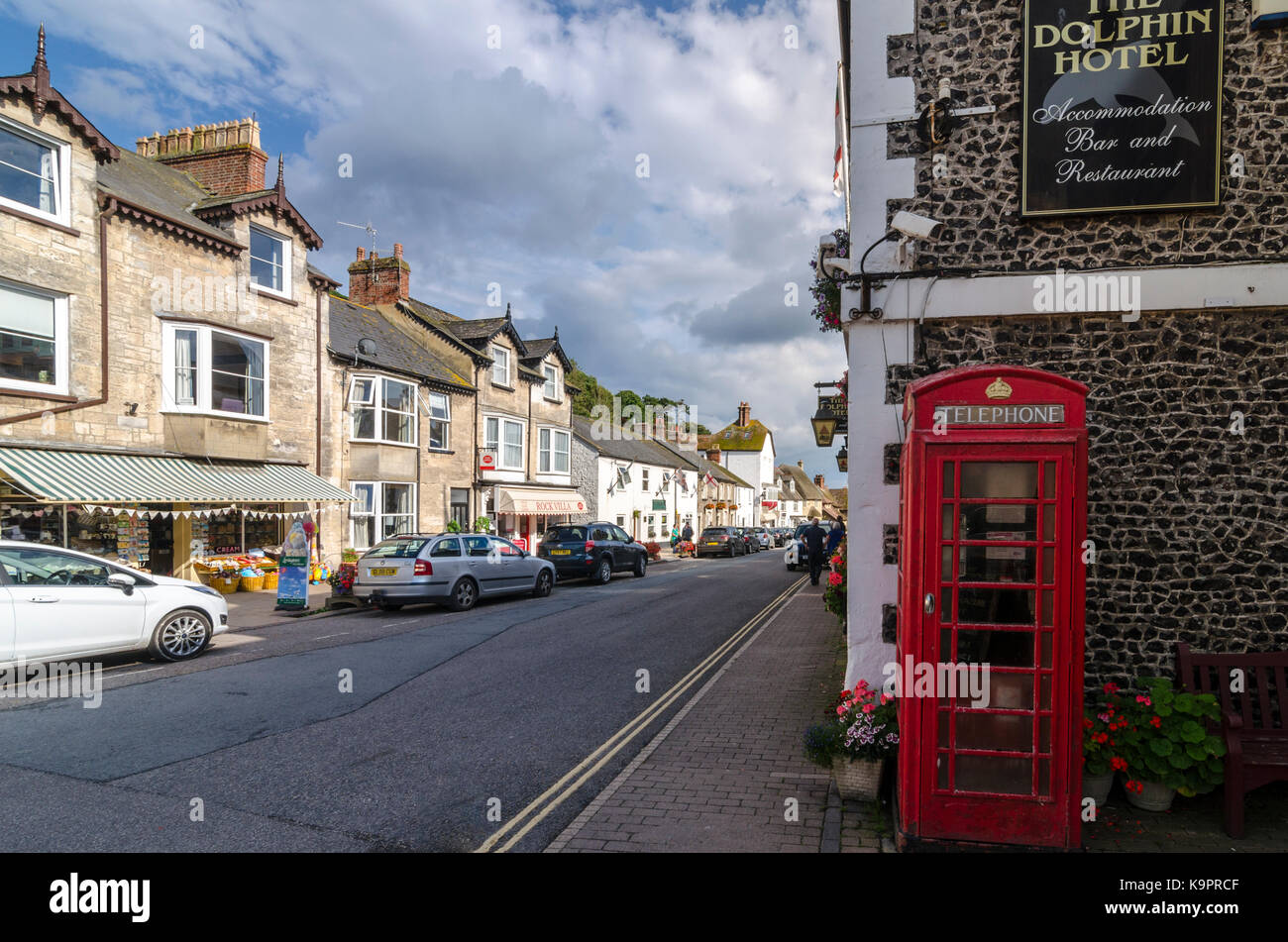 Telephone box on Fore Street, Beer, English Seaside Coastal town, East Devon Coast, England, UK - Stock Image