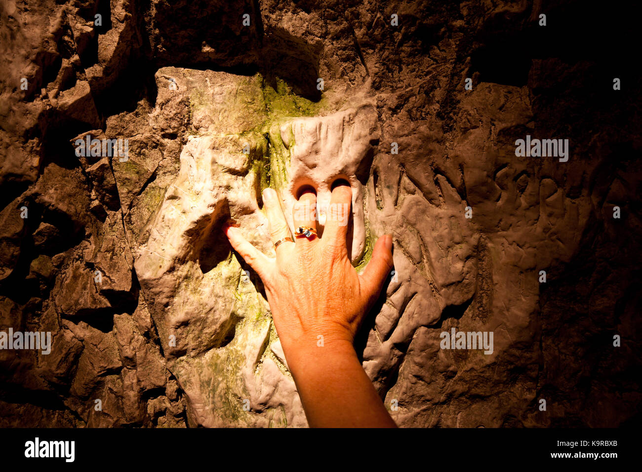 Chalk carving of face in hand-dug tunnel (placing fingers in eyes brings good luck). 2010. Hell-Fire Caves. West - Stock Image