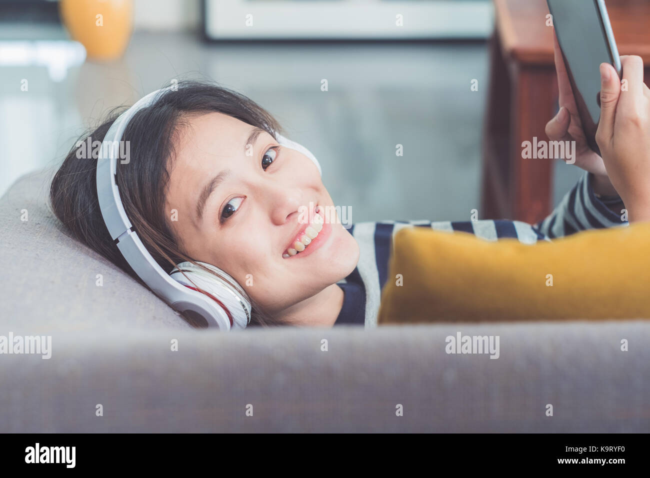 Close Up Asian Teenager Girl Wear Headphone Listening Music Play