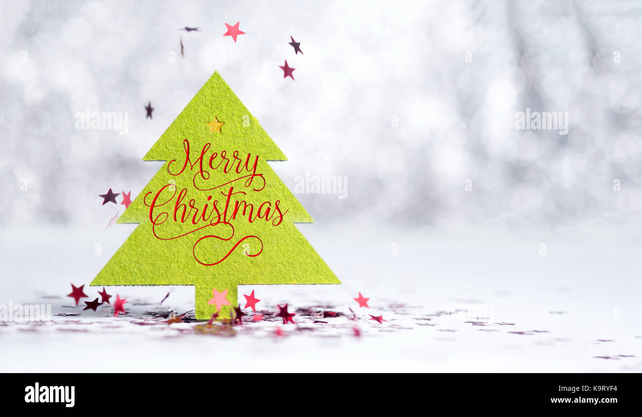 Close Up Merry Christmas Word On Green Tree With Sparkling Red Star Falling White Floor At Silver Background Bokeh LightWinter Holiday S