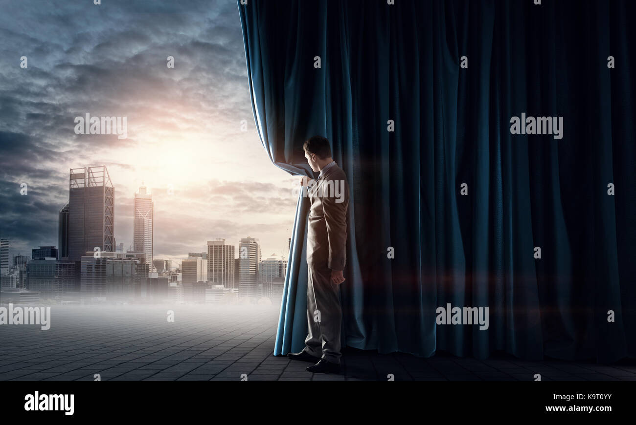 Night city behind curtain - Stock Image