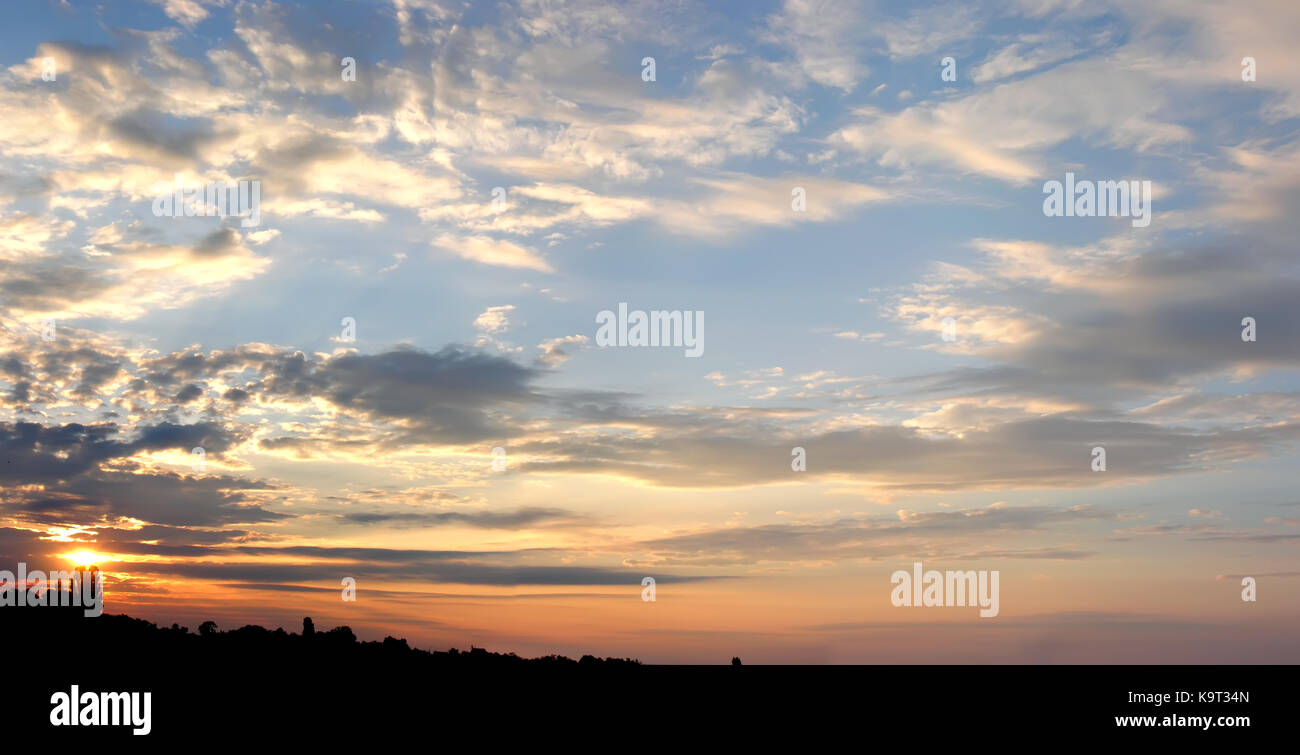 panoramic image of cloudy dramatic sky in the evening - Stock Image