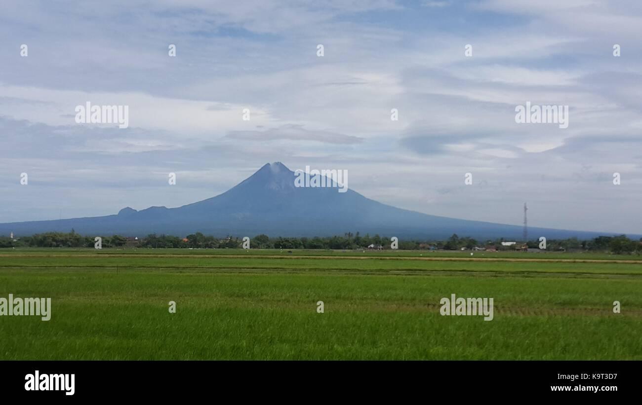 Merapi Mountain From Prambanan Village - Stock Image