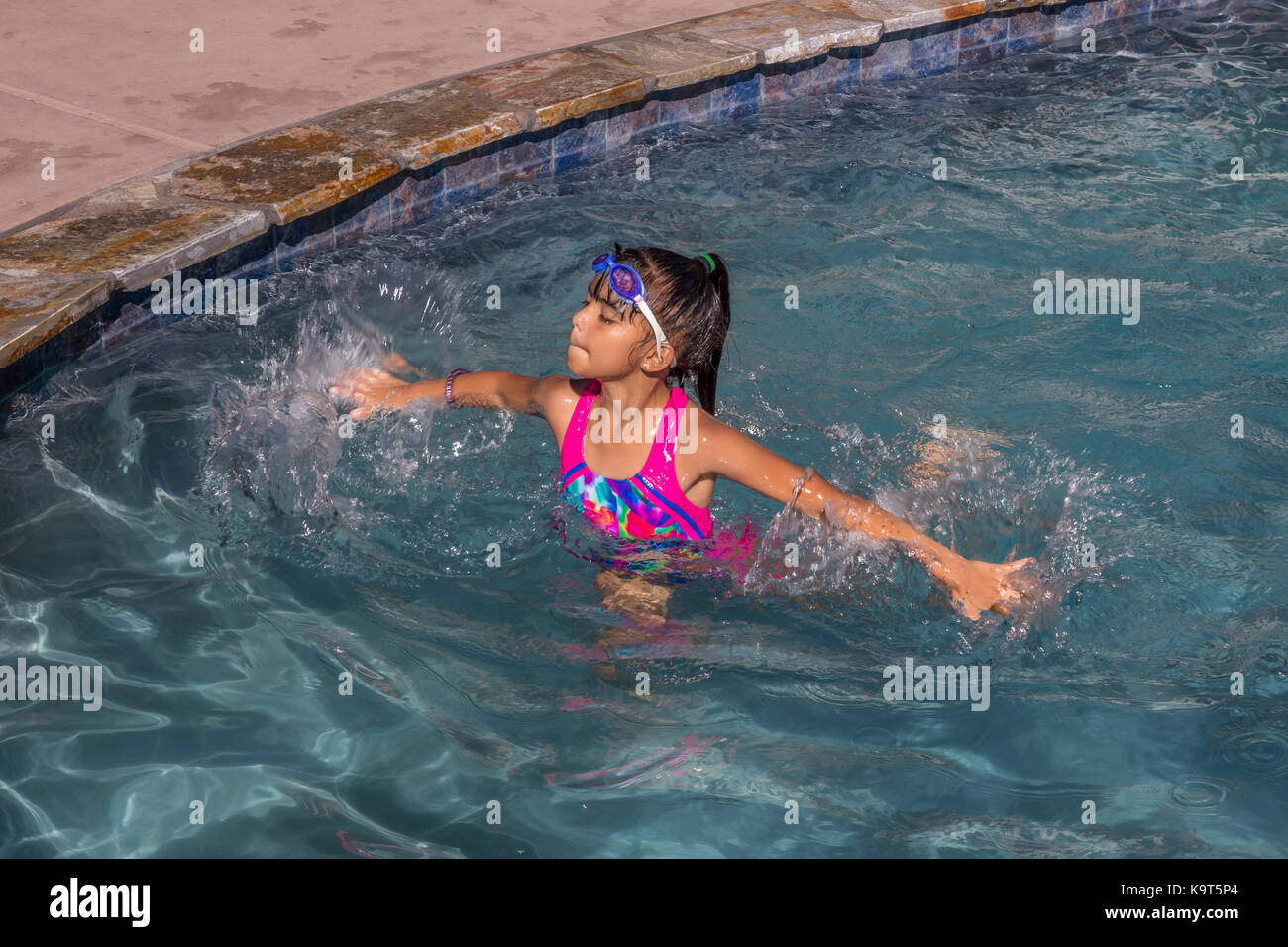 Kids pool party stock photos kids pool party stock images alamy for What is a freshwater swimming pool