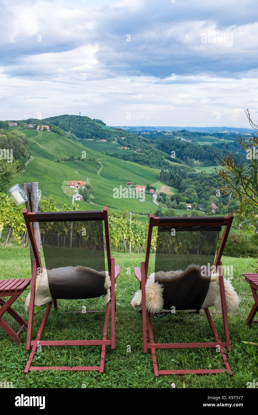 Two loungers with fur for relaxing near vineyard on south Styrian vine route in Austria, Europe - Stock Image