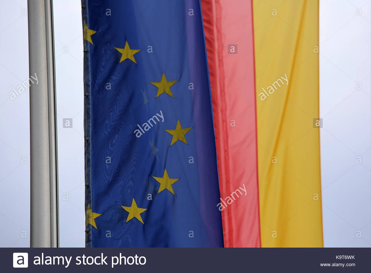 The EU and German flags side by side on a flagpole in the week of the German general election which returned Angela - Stock Image
