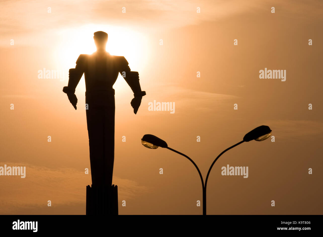 A monument to cosmonaut Yuri Gagarin in Moscow at sunset. Silhouette of the monument against the background of the - Stock Image