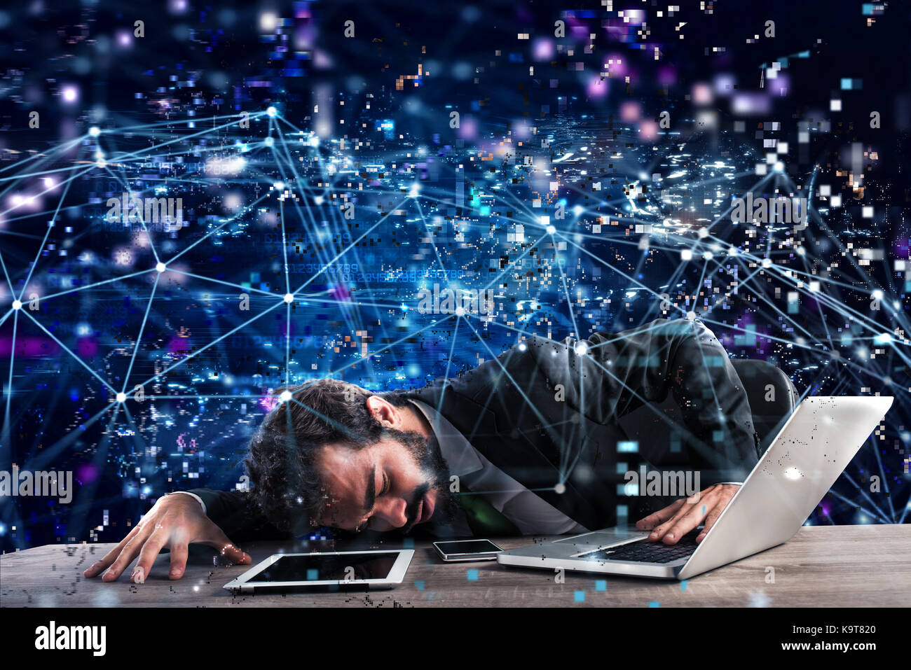 Businessman trapped in a technology network. Concept of internet addiction - Stock Image