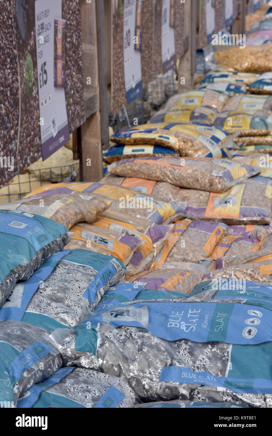 assorted bags of stones and different aggregates for landscaping and landscaped designing gardens at a garden centre - Stock Image