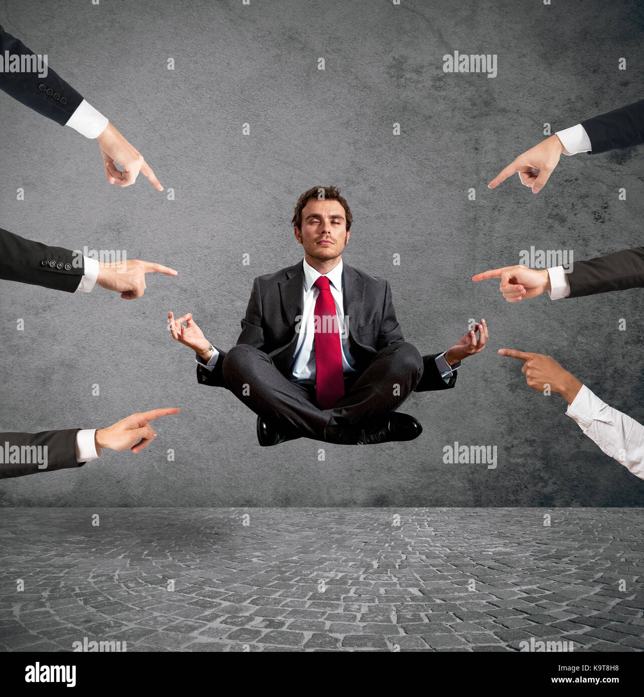 Relaxed businessman under the accusations of colleagues - Stock Image