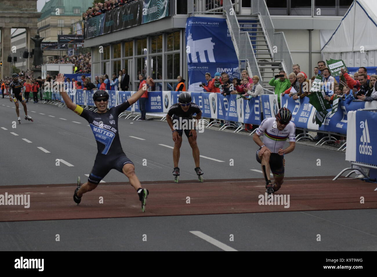 Berlin, Germany. 23rd Sep, 2017. Skaters cross the finishing line. Over 5,500 skater took part in the 2017 BMW Berlin Marathon Inline skating race, a day ahead of the Marathon race. Bart Swings from Belgium won the race in 58:42 for the 5th year in a row. Credit: Michael Debets/Pacific Press/Alamy Live News Stock Photo