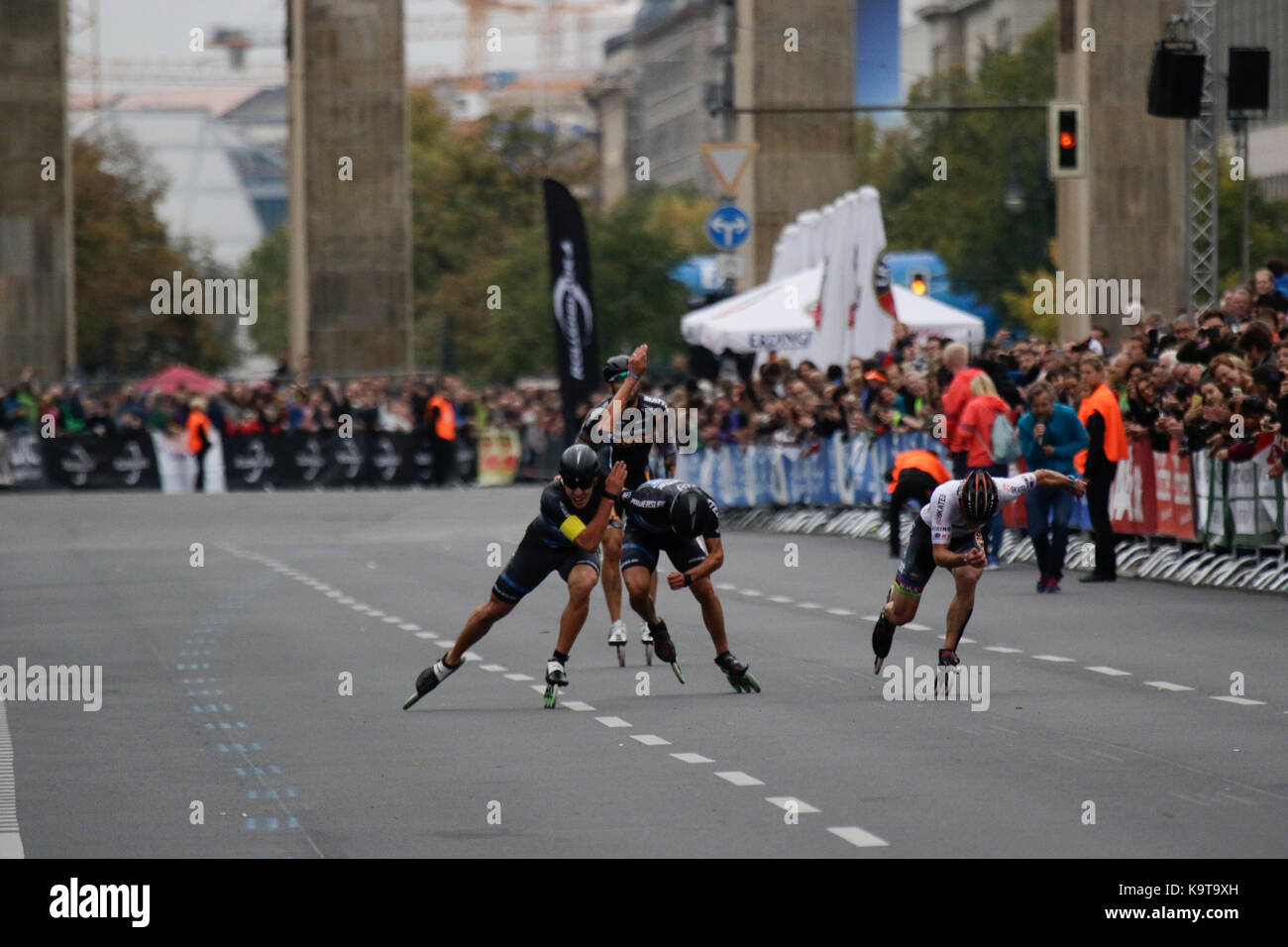 Berlin, Germany. 23rd Sep, 2017. Second place Patxi Peula from Spain crosses the finishing line.Skaters race the last meters of the course from the Brandenburg Gate to the finishing line. Over 5,500 skater took part in the 2017 BMW Berlin Marathon Inline skating race, a day ahead of the Marathon race. Bart Swings from Belgium won the race in 58:42 for the 5th year in a row. Credit: Michael Debets/Pacific Press/Alamy Live News Stock Photo