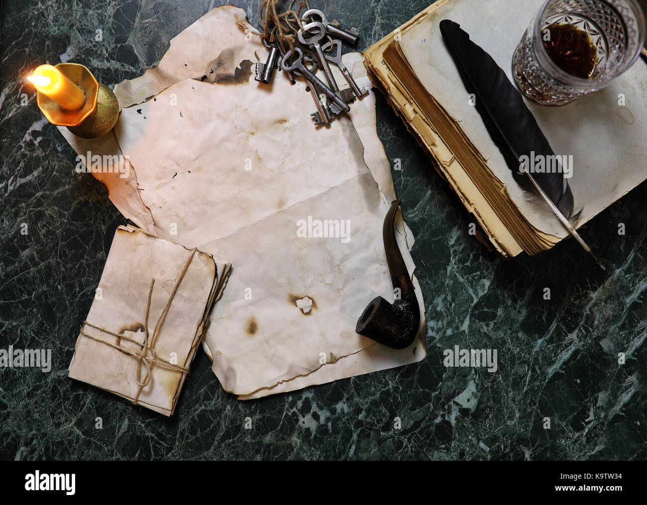 retro papers and book on table with detective tools background - Stock Image