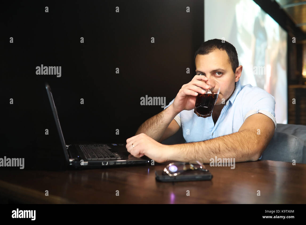 Armenian handsome man working behind laptop - Stock Image