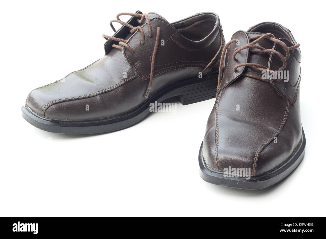 Dark brown leather men's shoes isolated on white background - Stock Image