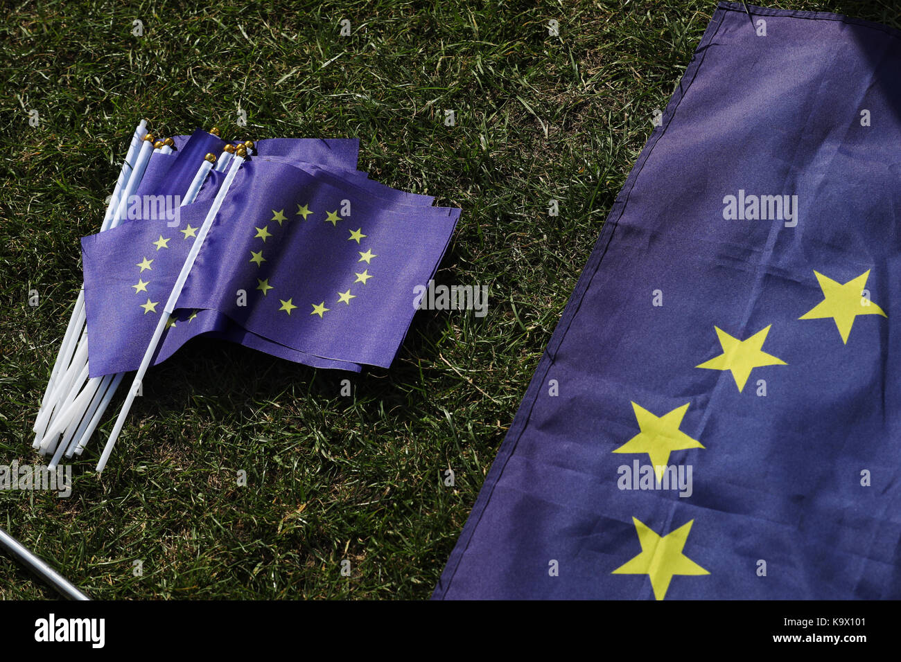 Brighton, UK. 24th September, 2017. European Union flags lay on the ground during a pro European Union protest against - Stock Image