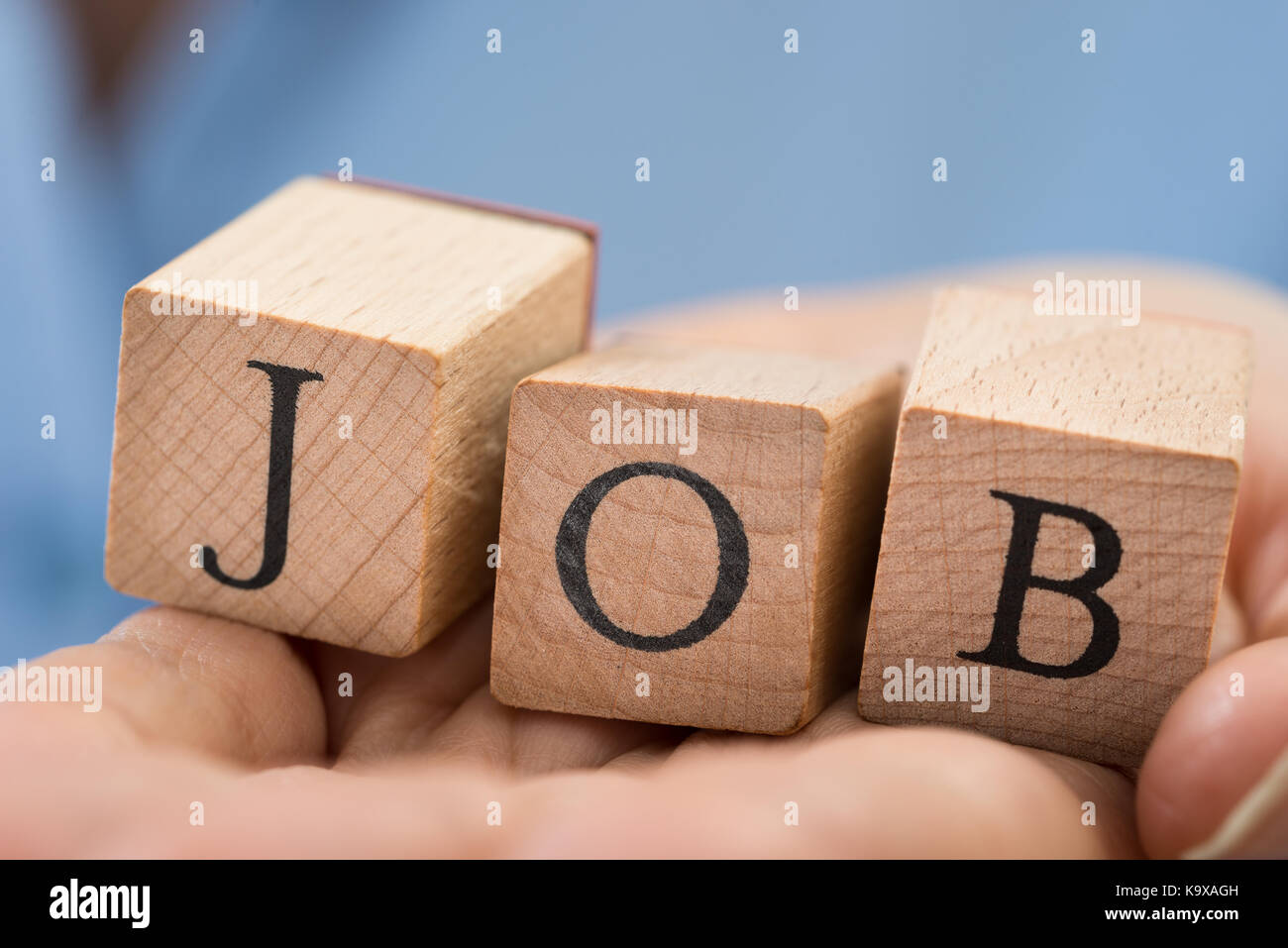 Close-up Of Person Hand Holding The Word Job On Blocks - Stock Image