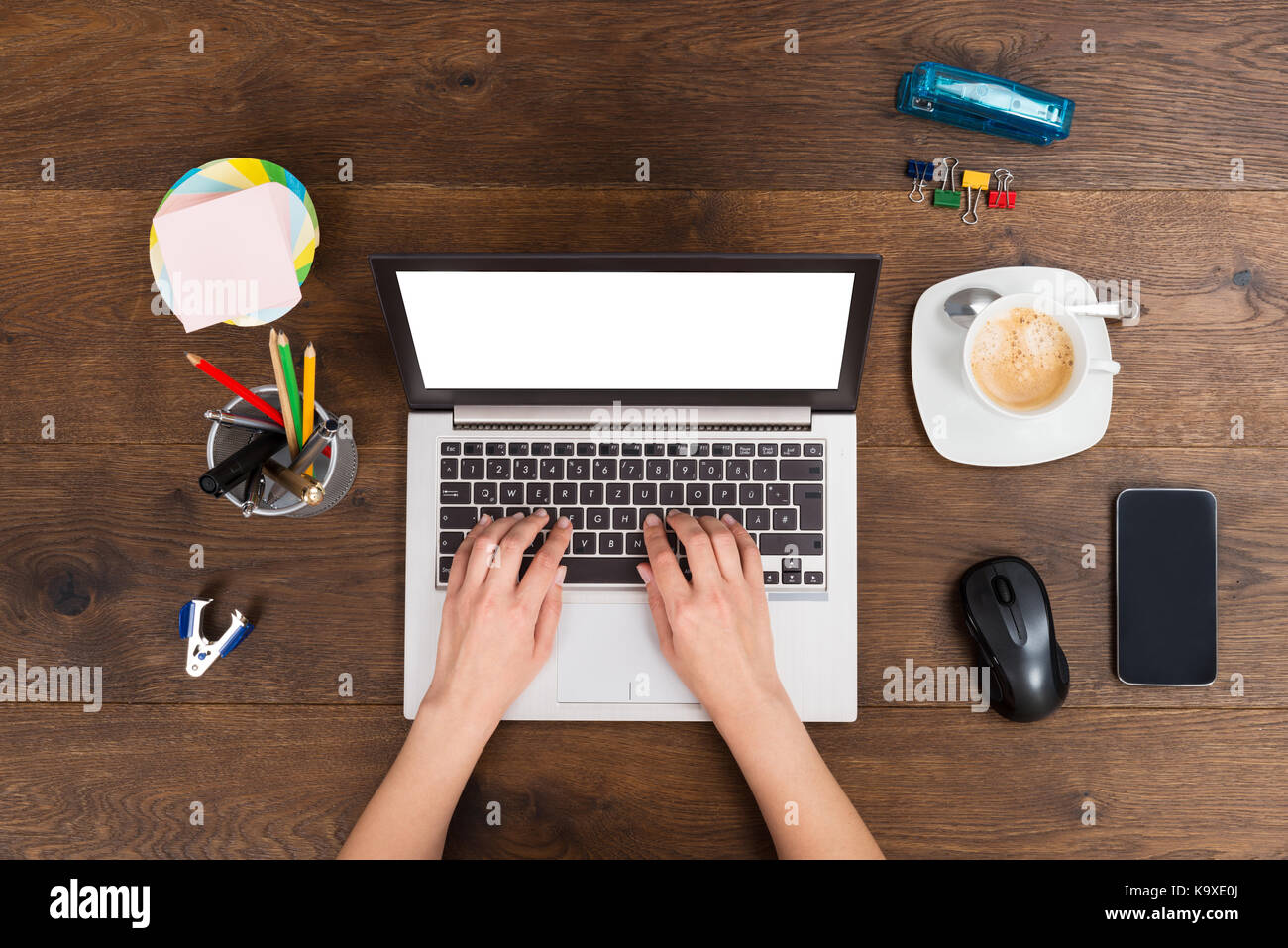 Close-up Of Person Hands Working On Laptop At Desk - Stock Image