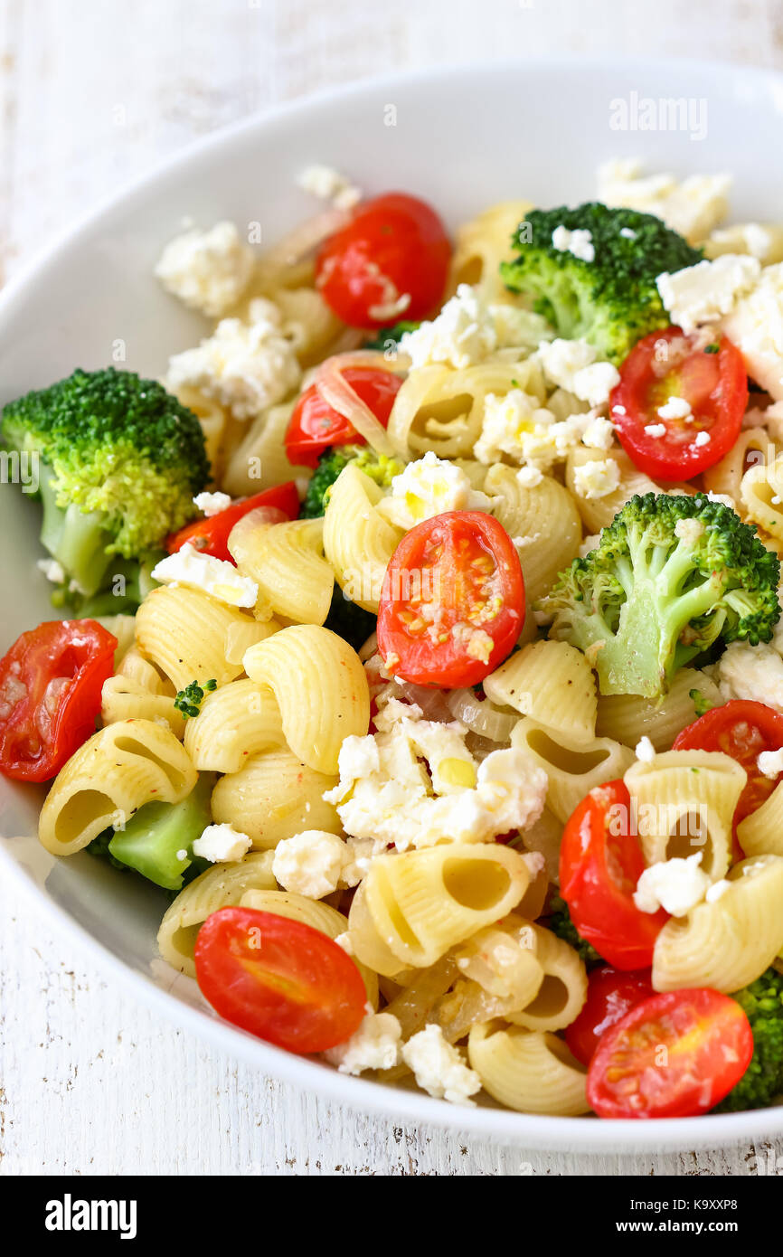 Pasta Salad with Broccoli, Tomato and Feta - Stock Image