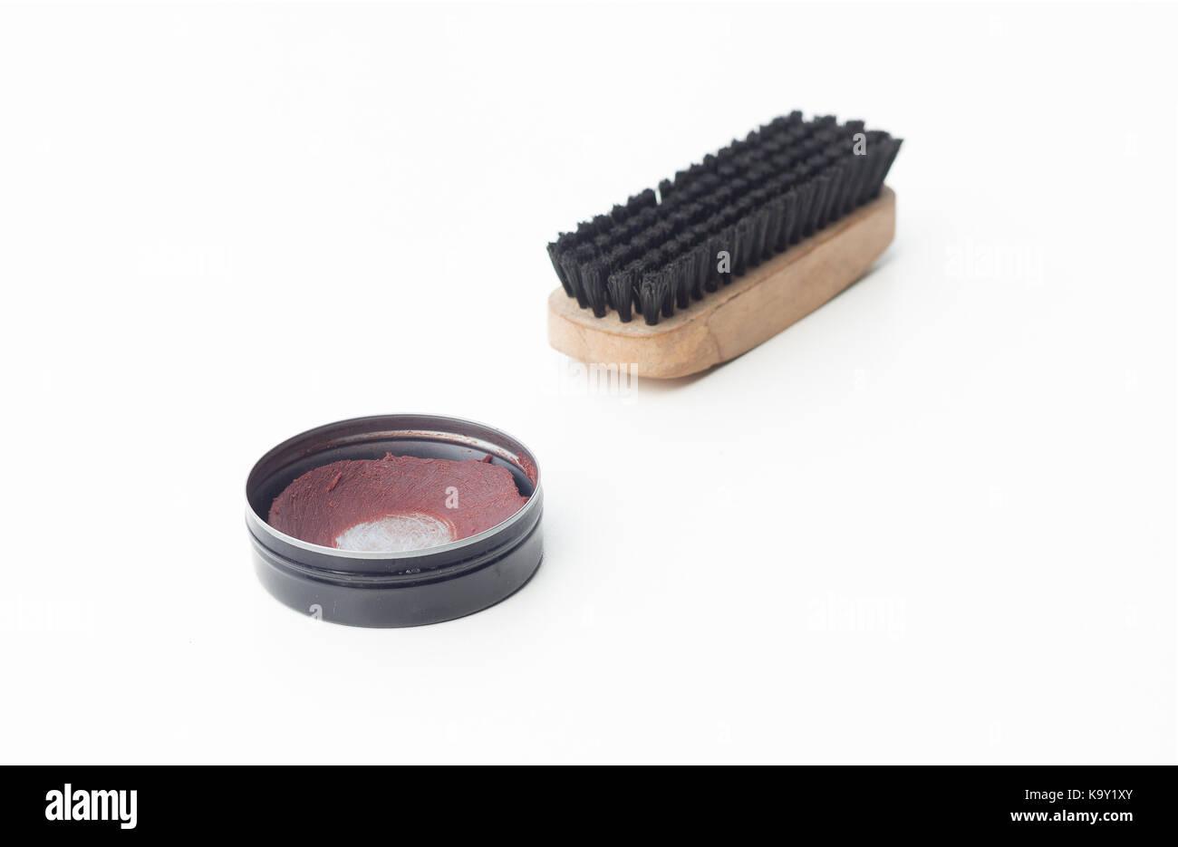 shoe polish and brush shoe isolated on white background - Stock Image