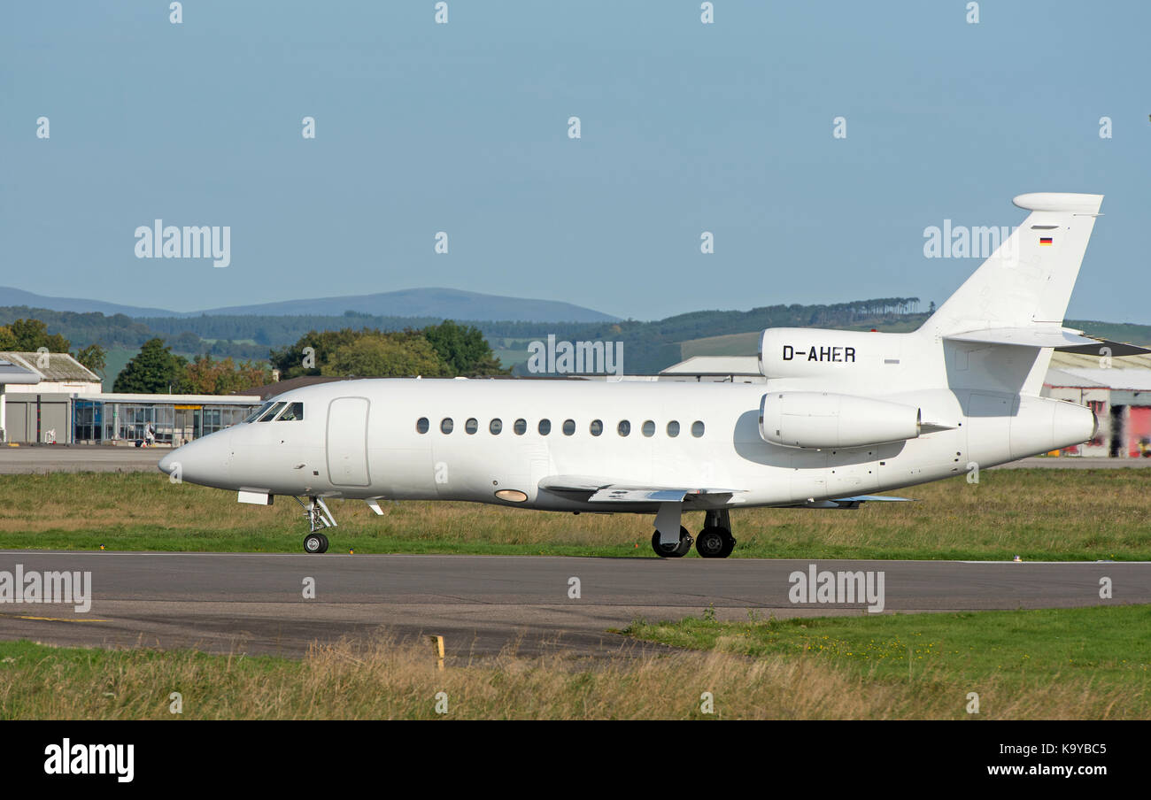 A Dassault 900ex business tri engined Jet arrives at iNVERNESS airport in the Scottish Highlands. Stock Photo