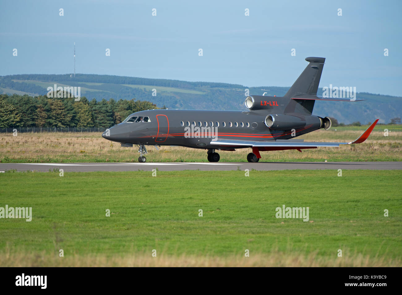 A French built Dassault 900EX Falcon business jet arriving at Inverness Airport in the sunshine. - Stock Image