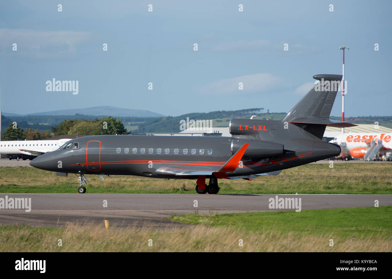 A French built Dassault 900EX Falcon business jet arriving at Inverness Airport in the sunshine. Stock Photo