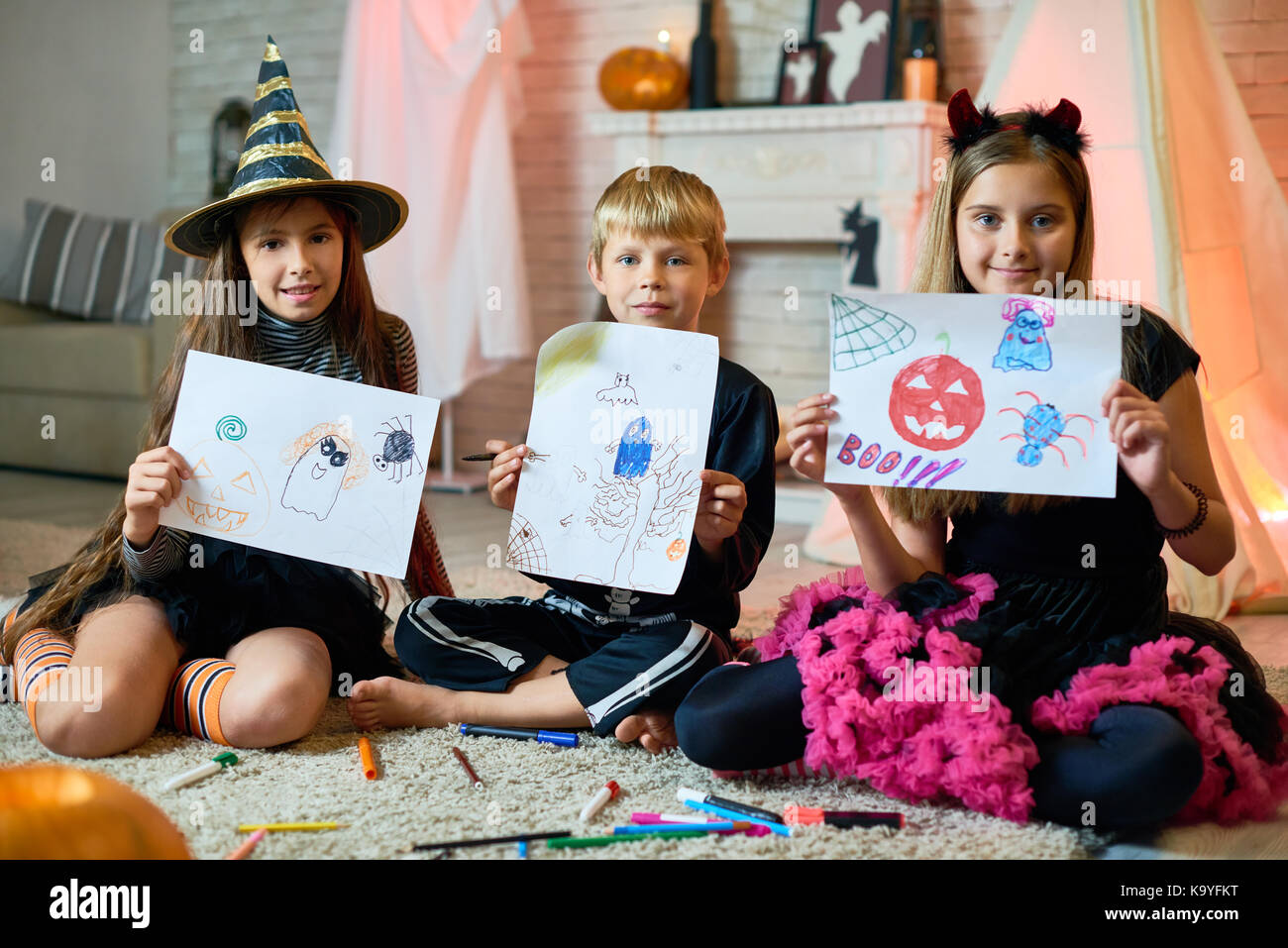 Cute Friend Halloween Costumes.Positive Cute Friends In Halloween Costumes Sitting On