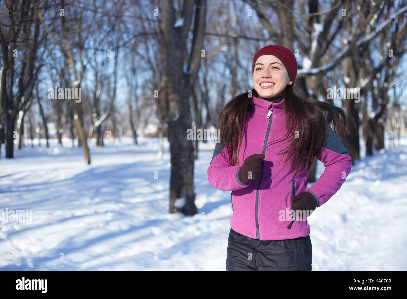 0cb2cf526d91 Running sport woman. Female runner jogging in cold winter forest wearing  warm sporty running clothing and gloves. Fitness happy girl running in  winter