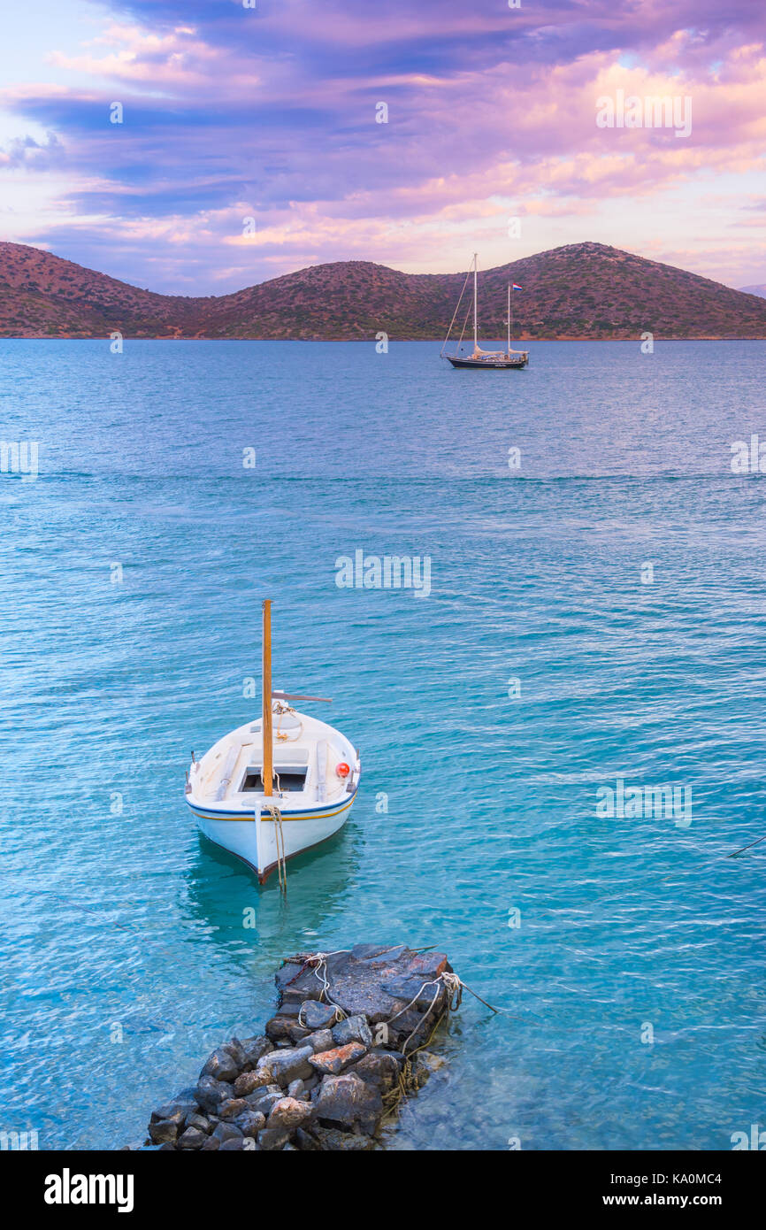 Sailing boat anchored in the peaceful gulf of Elounda, Crete. - Stock Image