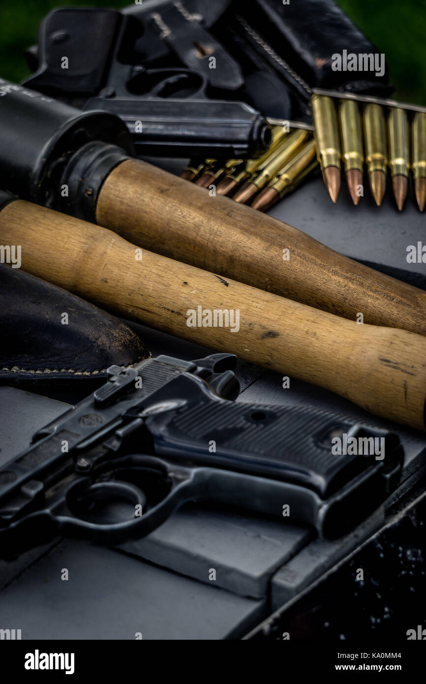 Pistols, grenades and ammunition display from WWII reenactors. - Stock Image