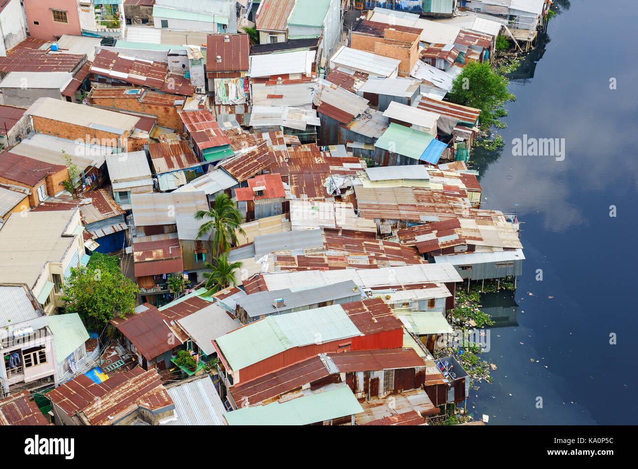Colorful slum houses at Ho Chi Minh city (view from top), Vietnam. Ho Chi Minh city (aka Saigon) is the largest - Stock Image