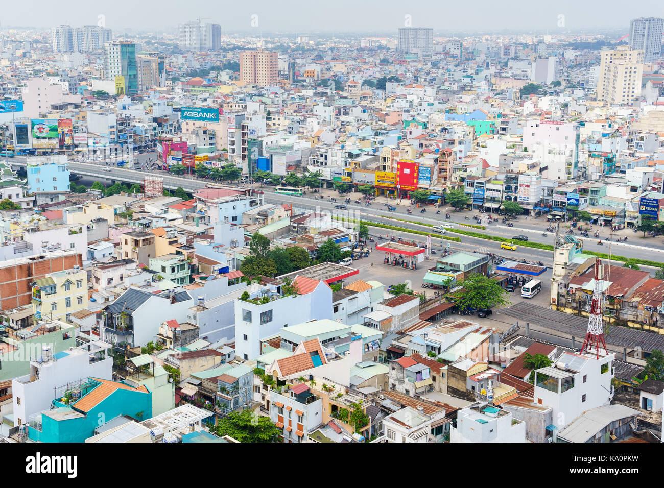 Ho Chi Minh city (or Saigon) skyline with colorful house, Vietnam. Saigon is the biggest city and economic center - Stock Image