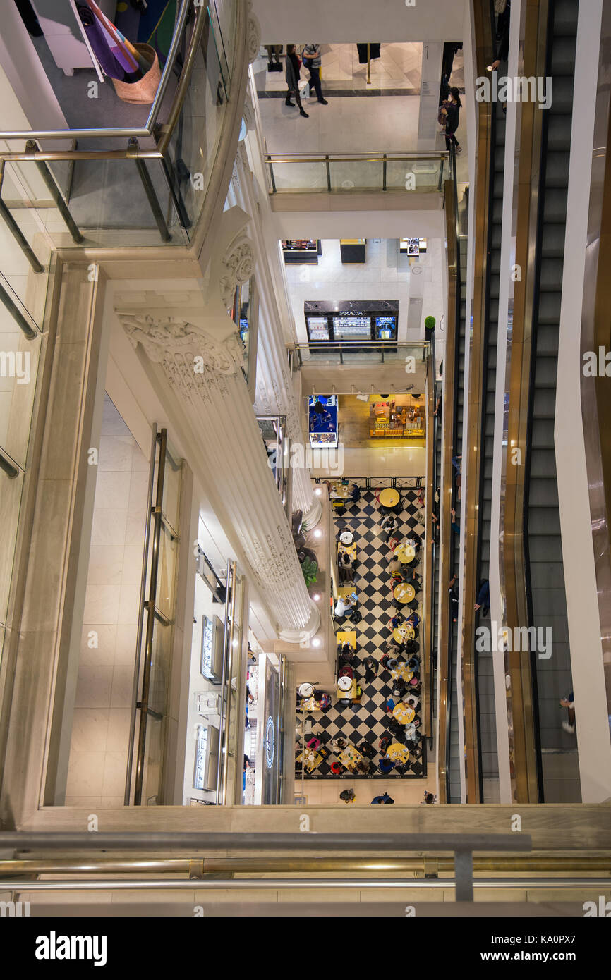 LONDON, ENGLAND - JUNE 09, 2017: Stairwell with shopping people in famous Selfridges department store London - Stock Image