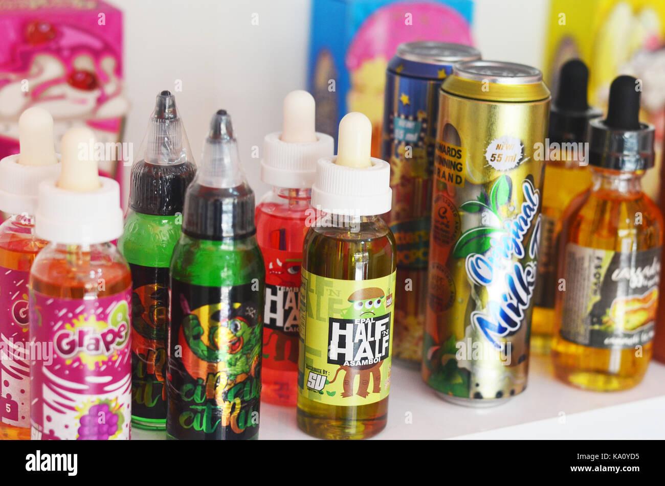 vape liquid and tools - Stock Image
