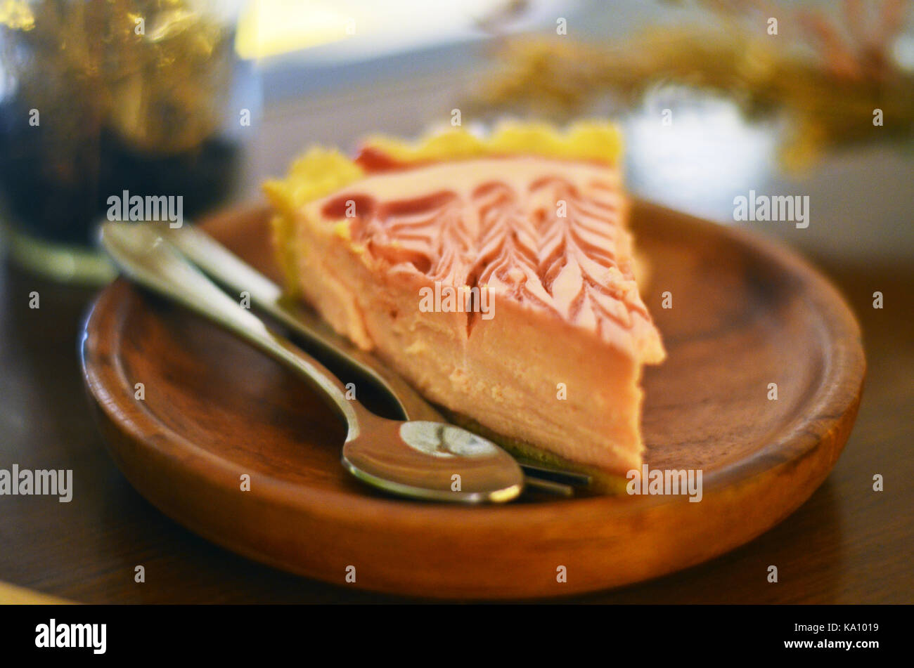 A pie is a baked dish which is usually made of a pastry dough casing covers or completely contains a filling of - Stock Image