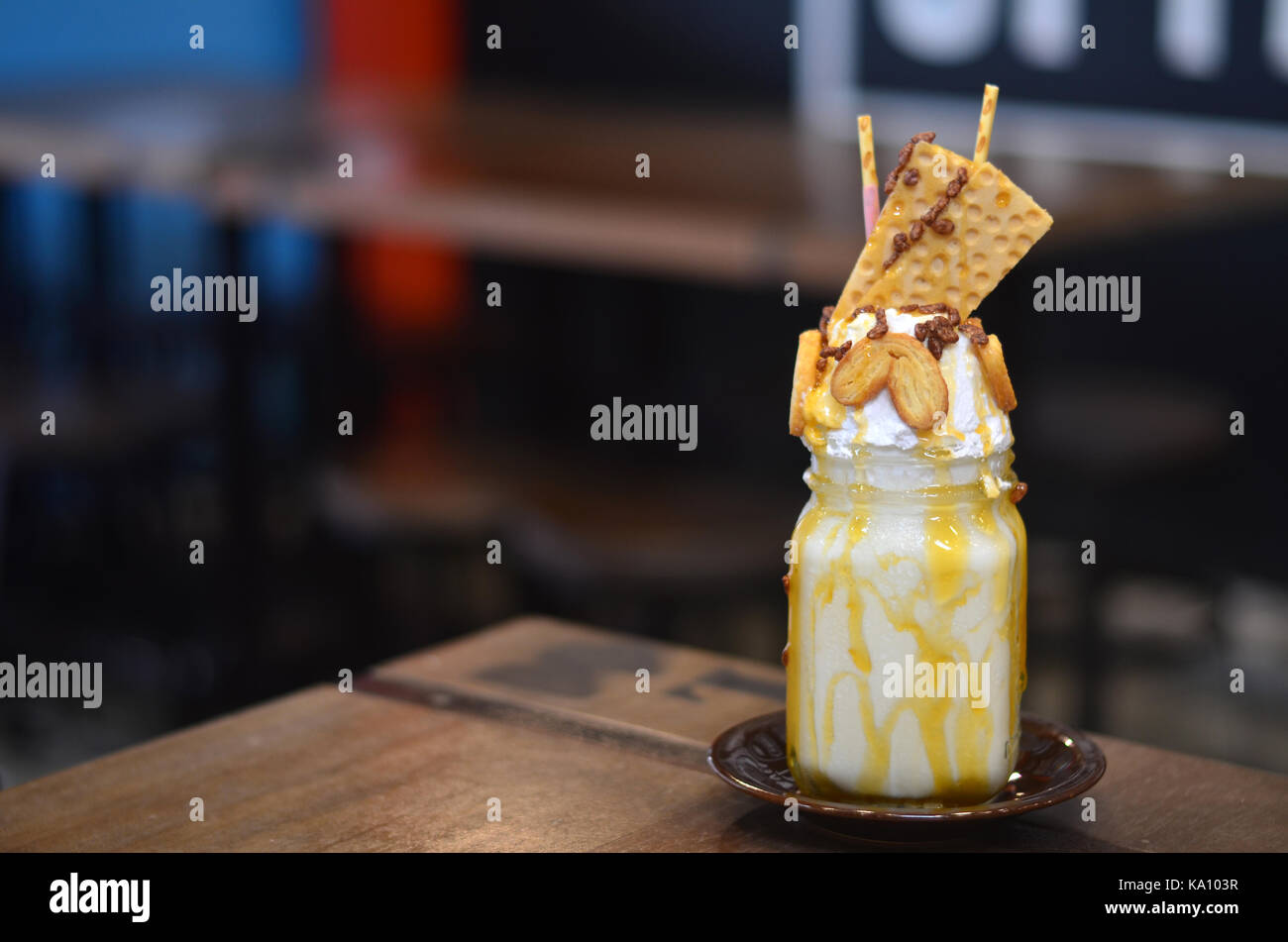 A milkshake is a sweet, cold beverage which is usually made from milk, ice cream, or iced milk, and flavorings or - Stock Image
