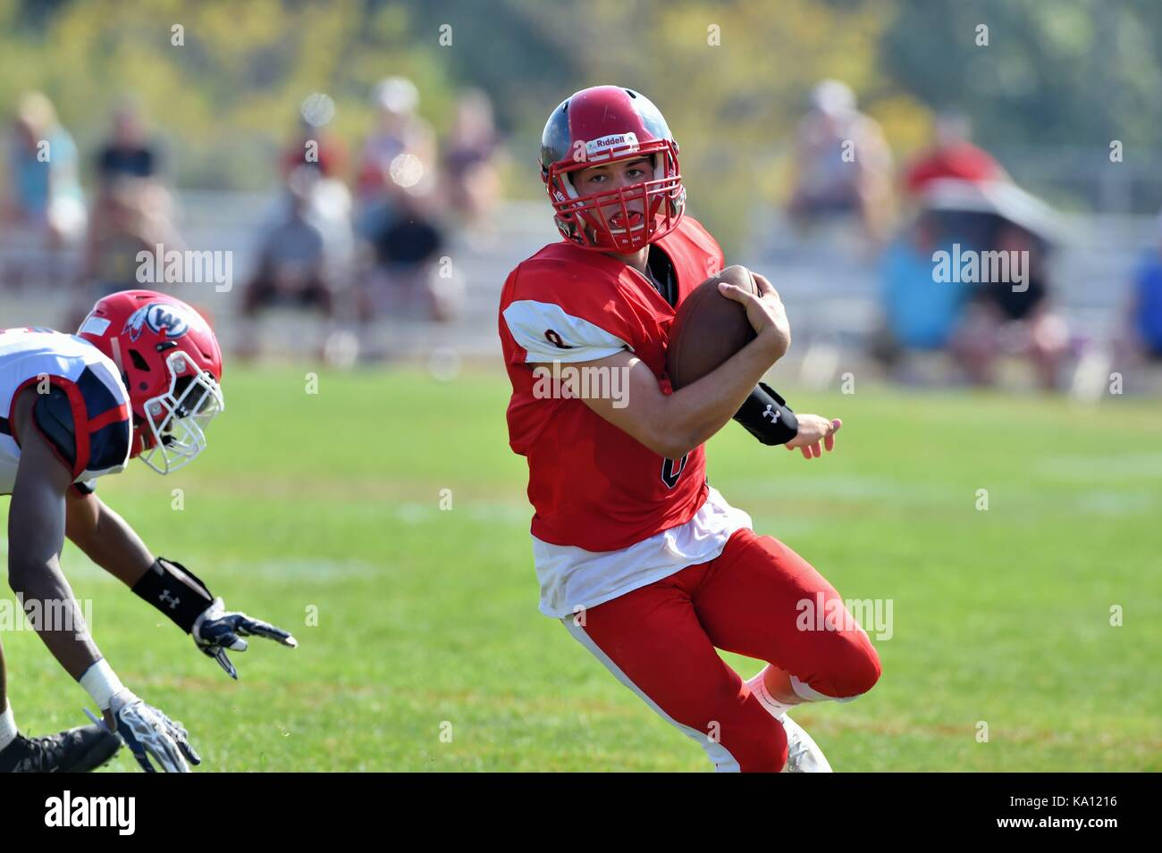 Quarterback running as an option after rolling out of the pocket. USA. - Stock Image